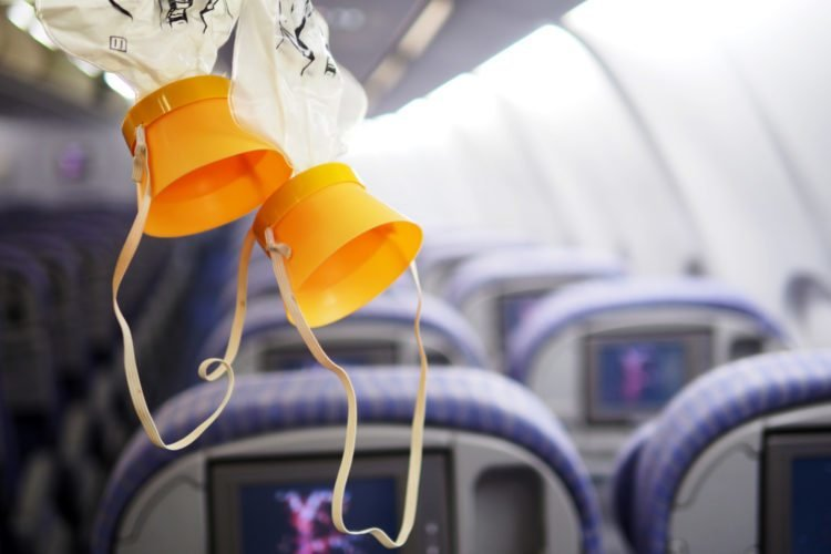 An image of oxygen masks on an airplane.